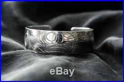 Hand carved coast salish native made hawk cuff bracelet. Kwakiutl. Mint, signed